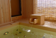 Hot Water Tap and Small Tub with Hot Water to Wash Off Your Body After Bathing